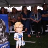 A bobblehead of Jamie Hosford sitting on a table at the Jamie Hosford Football Center dedication.